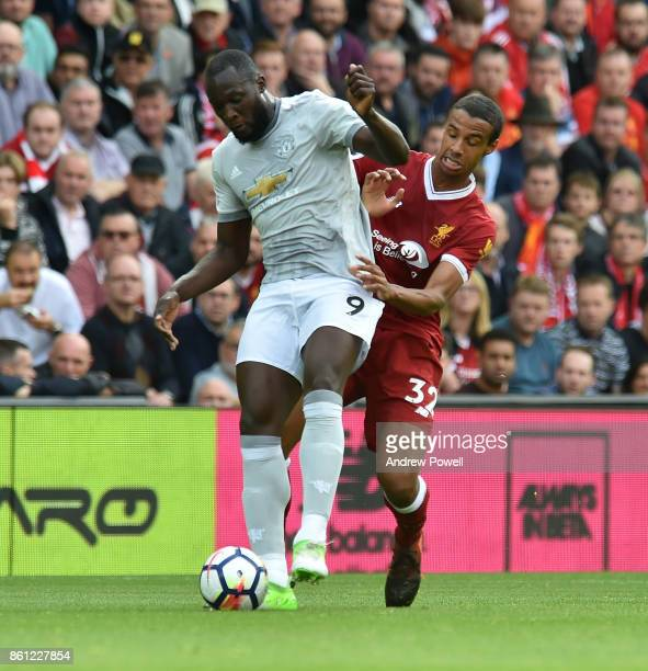 Joel Matip of Liverpool competes with Romelu Lukaku of Manchester United during the Premier League match between Liverpool and Manchester United at...