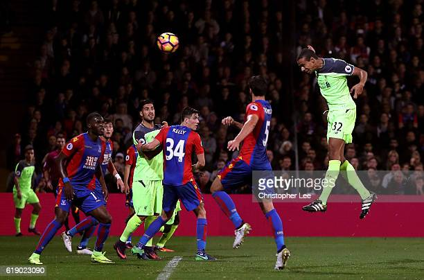 Joel Matip of Liverpool heads to score his team's third goal during the Premier League match between Crystal Palace and Liverpool at Selhurst Park on...