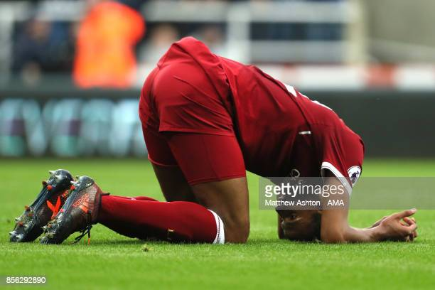 Joel Matip of Liverpool reacts after Newcastle's first goal during the Premier League match between Newcastle United and Liverpool at St James' Park...