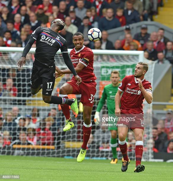 Joel Matip of Liverpool with Christian Benteke during the Premier League match between Liverpool and Crystal Palace at Anfield on August 19 2017 in...