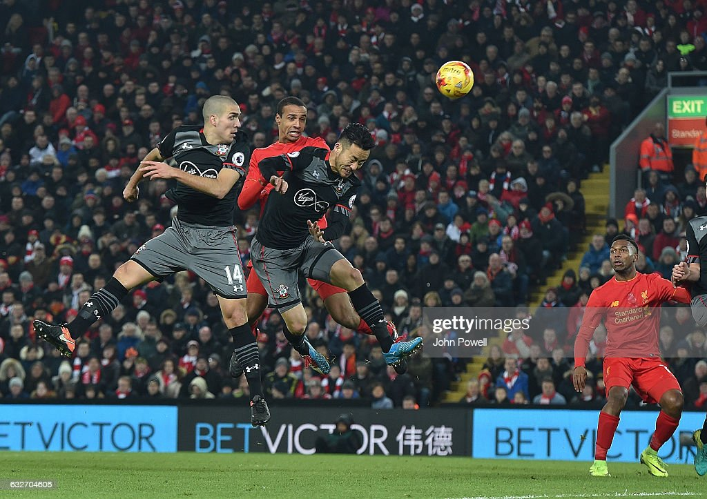 Joel Matip of Liverpool with Oriol Romeu of Southampton during the EFL Cup Semi-Final second leg match between Liverpool and Southampton at Anfield on January 25, 2017 in Liverpool, England.