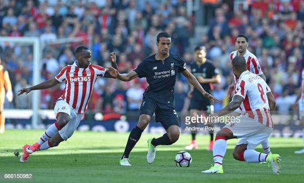 Joel Matip of Liverpool with Saido Berahino of Stoke City during the Premier League match between Stoke City and Liverpool at Bet365 Stadium on April...