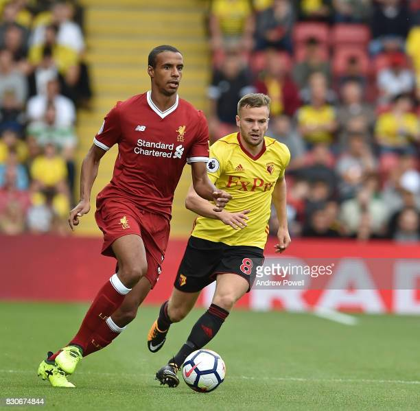 Joel Matip of Liverpool with Tom Cleverley of watford during the Premier League match between Watford and Liverpool at Vicarage Road on August 12...