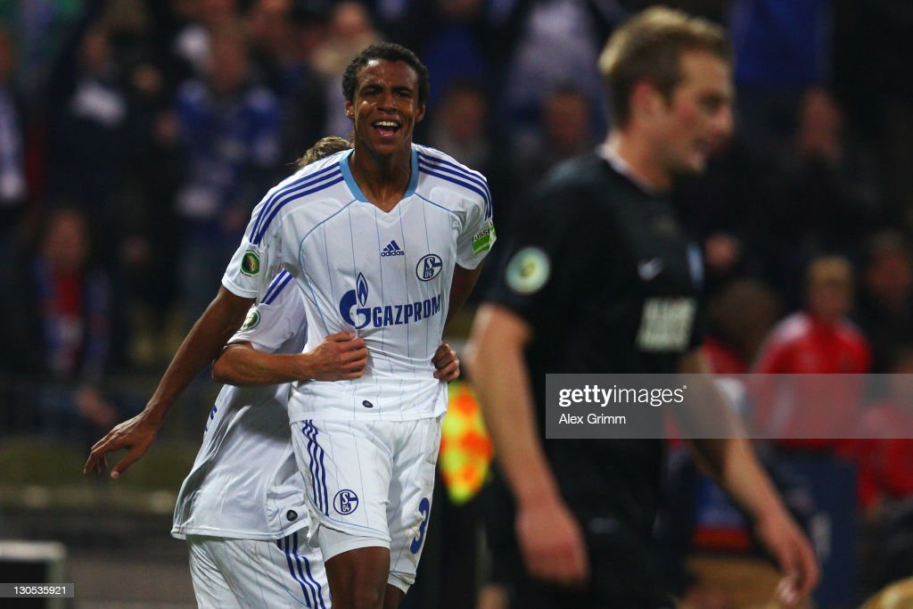 <a gi-track='captionPersonalityLinkClicked' href=/galleries/search?phrase=Joel+Matip&family=editorial&specificpeople=4462851 ng-click='$event.stopPropagation()'>Joel Matip</a> of Schalke celebrates his team's second goal during the DFB Cup second round match between Karlsruher SC and FC Schalke 04 at Wildpark Stadium on October 26, 2011 in Karlsruhe, Germany.