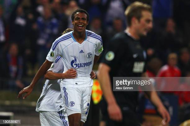 Joel Matip of Schalke celebrates his team's second goal during the DFB Cup second round match between Karlsruher SC and FC Schalke 04 at Wildpark...