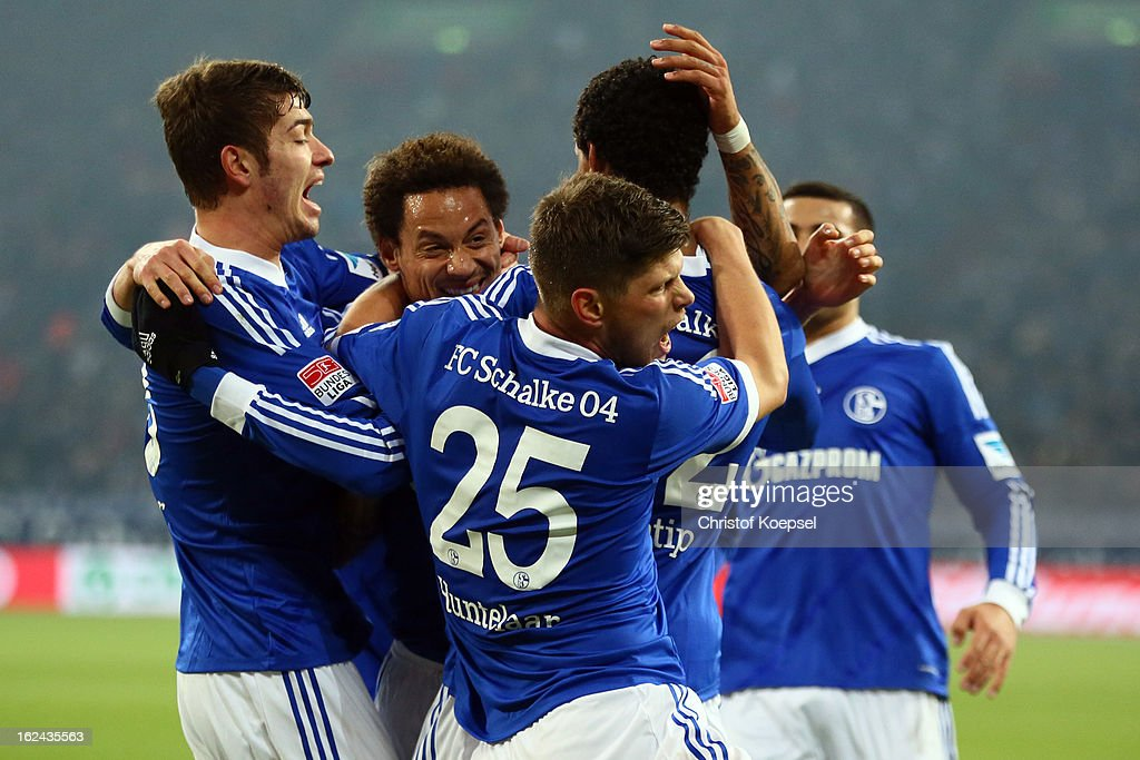 <a gi-track='captionPersonalityLinkClicked' href=/galleries/search?phrase=Joel+Matip&family=editorial&specificpeople=4462851 ng-click='$event.stopPropagation()'>Joel Matip</a> of Schalke (2nd R) celebrates the first goal with Roman Neustaedter(L), <a gi-track='captionPersonalityLinkClicked' href=/galleries/search?phrase=Jermaine+Jones+-+Joueur+de+football&family=editorial&specificpeople=12906336 ng-click='$event.stopPropagation()'>Jermaine Jones</a> (2nd L) and Klaas-Jan Huntelaar (R) during the Bundesliga match between FC Schalke 04 and Fortuna Duesseldorf at Veltins-Arena on February 23, 2013 in Gelsenkirchen, Germany.