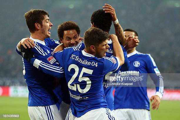 Joel Matip of Schalke celebrates the first goal with Roman Neustaedter Jermaine Jones and KlaasJan Huntelaar during the Bundesliga match between FC...