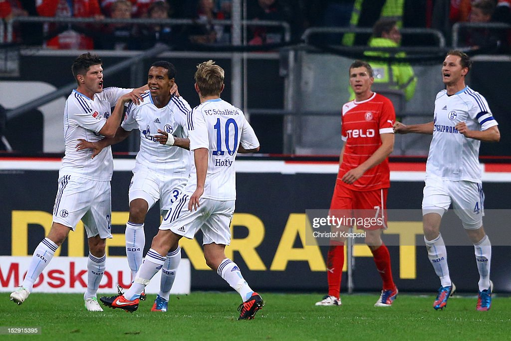 Joel Matip of Schalke (2nd L) celebrates the second goal with Klaas-Jan Huntelaar (L) and <a gi-track='captionPersonalityLinkClicked' href=/galleries/search?phrase=Lewis+Holtby&family=editorial&specificpeople=5351202 ng-click='$event.stopPropagation()'>Lewis Holtby</a> (3rd L) during the Bundesliga match between Fortuna Duesseldorf and FC Schalke 04 at Esprit-Arena on September 28, 2012 in Duesseldorf, Germany.