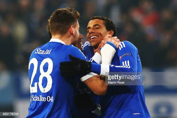 Joel Matip of Schalke celebrates with team mate Adam Szalai after scoring his sides second goal during the UEFA Champions League Group E match...