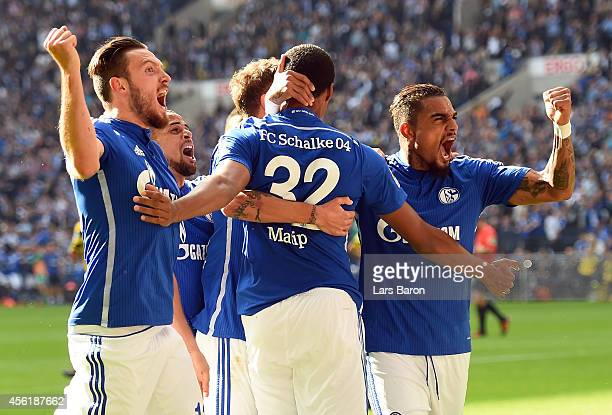 Joel Matip of Schalke celebrates with team mates after scoring his teams first goal during the Bundesliga match between FC Schalke 04 and Borussia...