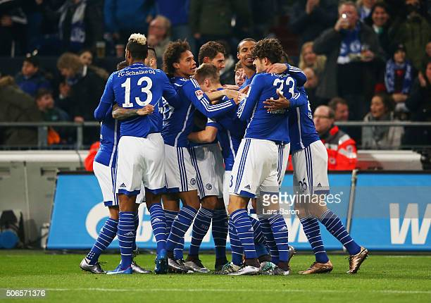 Joel Matip of Schalke celebrates with team mates as he scores their first goal during the Bundesliga match between FC Schalke 04 and Werder Bremen at...