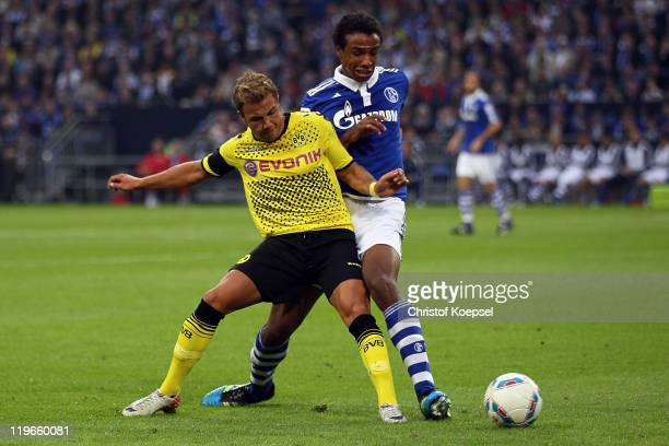 Joel Matip of Schalke challenchallenges Mario Goetze of Dormtund during the Supercup match between FC Schalke 04 and Borussia Dortmund at Veltins...