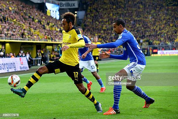 Joel Matip of Schalke challenges PierreEmerick Aubameyang of Dortmund during the Bundesliga match between Borussia Dortmund and FC Schalke 04 at...