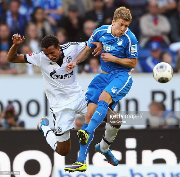 Joel Matip of Schalke jumps for a header with Sven Schipplock of Hoffenheim during the Bundesliga match between 1899 Hoffenheim and FC Schalke 04 on...