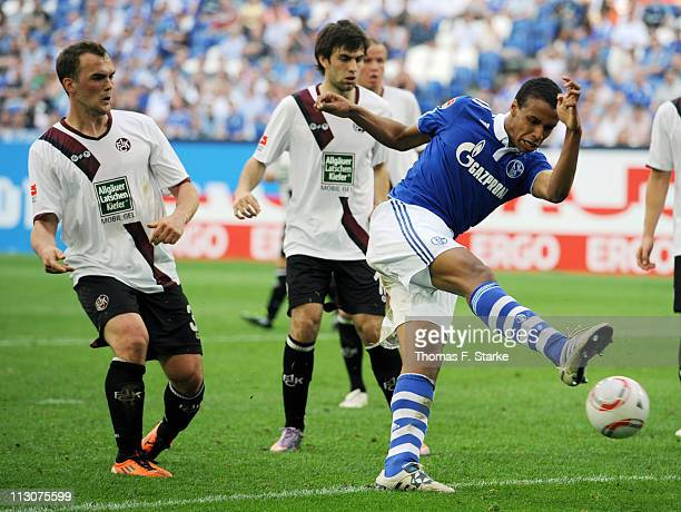 Joel Matip of Schalke misses to score while Erwin Hoffer and Jan Moravek of Kaiserslautern look on during the Bundesliga match between FC Schalke 04...