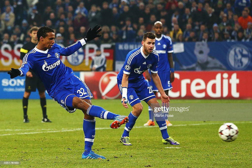 <a gi-track='captionPersonalityLinkClicked' href=/galleries/search?phrase=Joel+Matip&family=editorial&specificpeople=4462851 ng-click='$event.stopPropagation()'>Joel Matip</a> (L) of Schalke scores his sides second goal during the UEFA Champions League Group E match between FC Schalke 04 and FC Basel 1893 at the Veltins-Arena on December 11, 2013 in Gelsenkirchen, Germany.