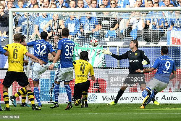 Joel Matip of Schalke scores the opening goal from a header as goalkeeper Roman Weidenfeller of Dortmund tries to save during the Bundesliga match...