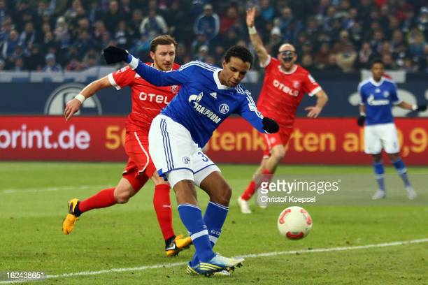 Joel Matip of Schalke scores the second goal against Adam Bodzek of Duesseldorf during the Bundesliga match between FC Schalke 04 and Fortuna...