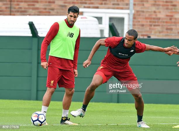Joel Matip with Emre Can of Liverpool during a training session at Melwood Training Ground on August 10 2017 in Liverpool England
