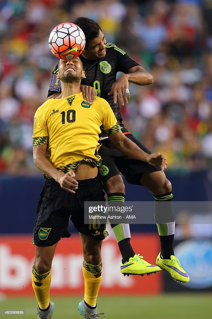 Joel McAnuff #10 of Jamaica and Jesus Corona #9 of Mexico go for a header during the 2015 CONCACAF Gold Cup Final match between Jamaica and Mexico at Lincoln Financial Field on July 26, 2015 in Philadelphia,Pennsylvania.