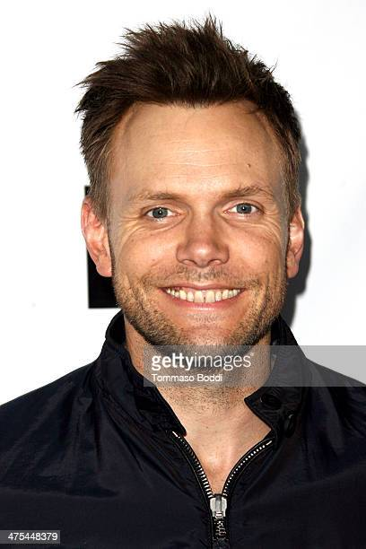 Joel McHale attends the USIreland alliance preAcademy Awards event held at Bad Robot on February 27 2014 in Santa Monica California