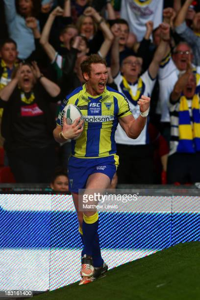 Joel Monaghan of Warrington celebrates after scoring his team's first try during the Super League Grand Final between Warrington Wolves and Wigan...
