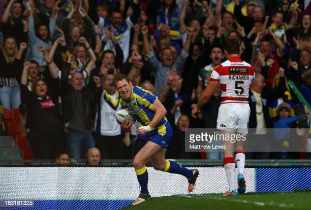 Joel Monaghan of Warrington celkebrates after scoring his team's first try during the Super League Grand Final between Warrington Wolves and Wigan...