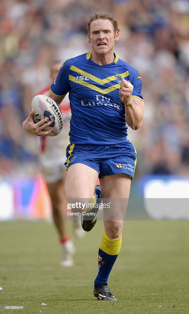 Joel Monaghan of Warrington Wolves in action during the Super League match between Warrington Wolves and St Helens at Etihad Stadium on May 18, 2014 in Manchester, England.
