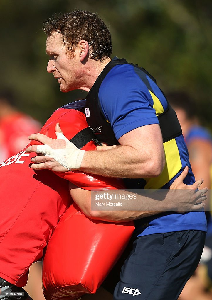 <a gi-track='captionPersonalityLinkClicked' href=/galleries/search?phrase=Joel+Monaghan&family=editorial&specificpeople=242932 ng-click='$event.stopPropagation()'>Joel Monaghan</a> of Warrington Wolves performs a tackling drill during a Sydney Swans AFL pre-season training session at Lakeside Oval on January 15, 2014 in Sydney, Australia.
