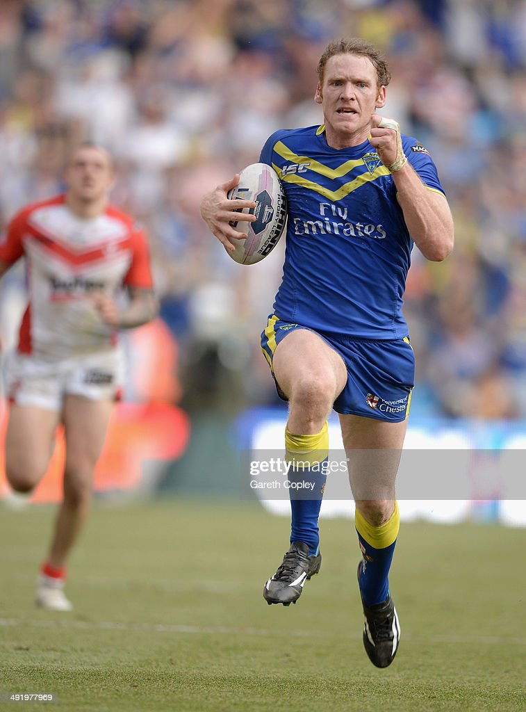 <a gi-track='captionPersonalityLinkClicked' href=/galleries/search?phrase=Joel+Monaghan&family=editorial&specificpeople=242932 ng-click='$event.stopPropagation()'>Joel Monaghan</a> of Warrington Wolves runs in a second half try during the Super League match between Warrington Wolves and St Helens at Etihad Stadium on May 18, 2014 in Manchester, England.