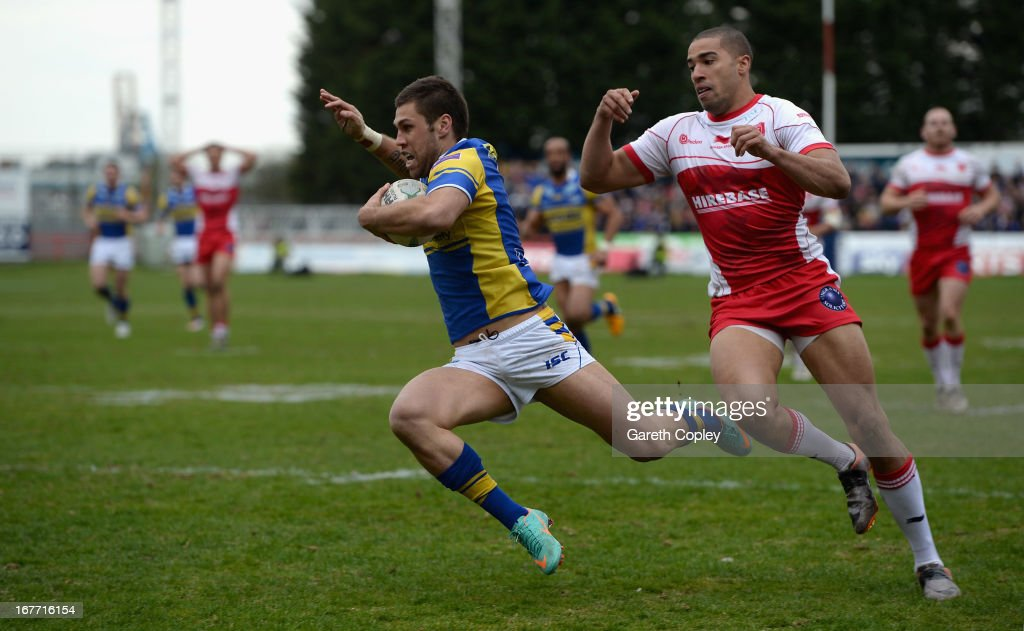 Joel Moon of Leeds dives past Omari Caro of Hull KR to score his second half try during the Super League match between Hull Kingston Rovers and Leeds Rhinos at Craven Park Stadium on April 28, 2013 in Hull, England.
