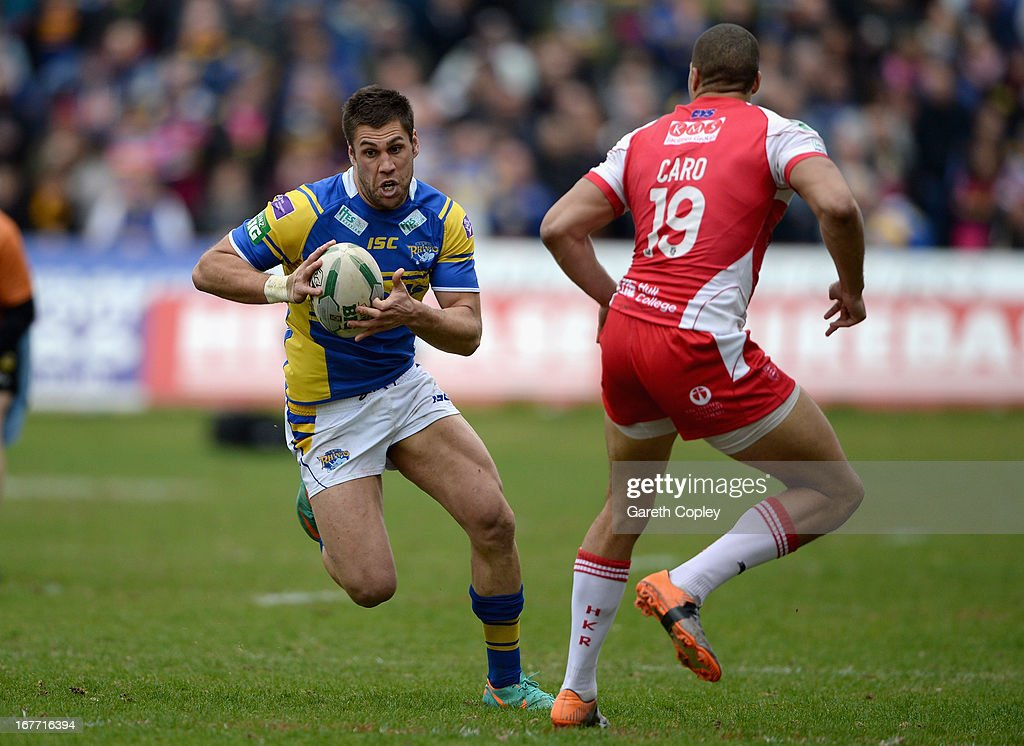 Joel Moon of Leeds gets past Omari Caro of Hull KR to score his second half try during the Super League match between Hull Kingston Rovers and Leeds Rhinos at Craven Park Stadium on April 28, 2013 in Hull, England.