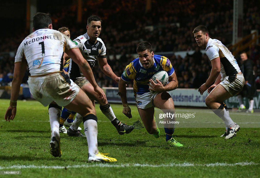 Joel Moon of Leeds Rhinos beats Shannon McDonnell of Hull FC on his way to scoring his try during the Stobart Super League match between Leeds Rhinos and Hull FC at Headingley Carnegie Stadium on February 1, 2013 in Leeds, England.