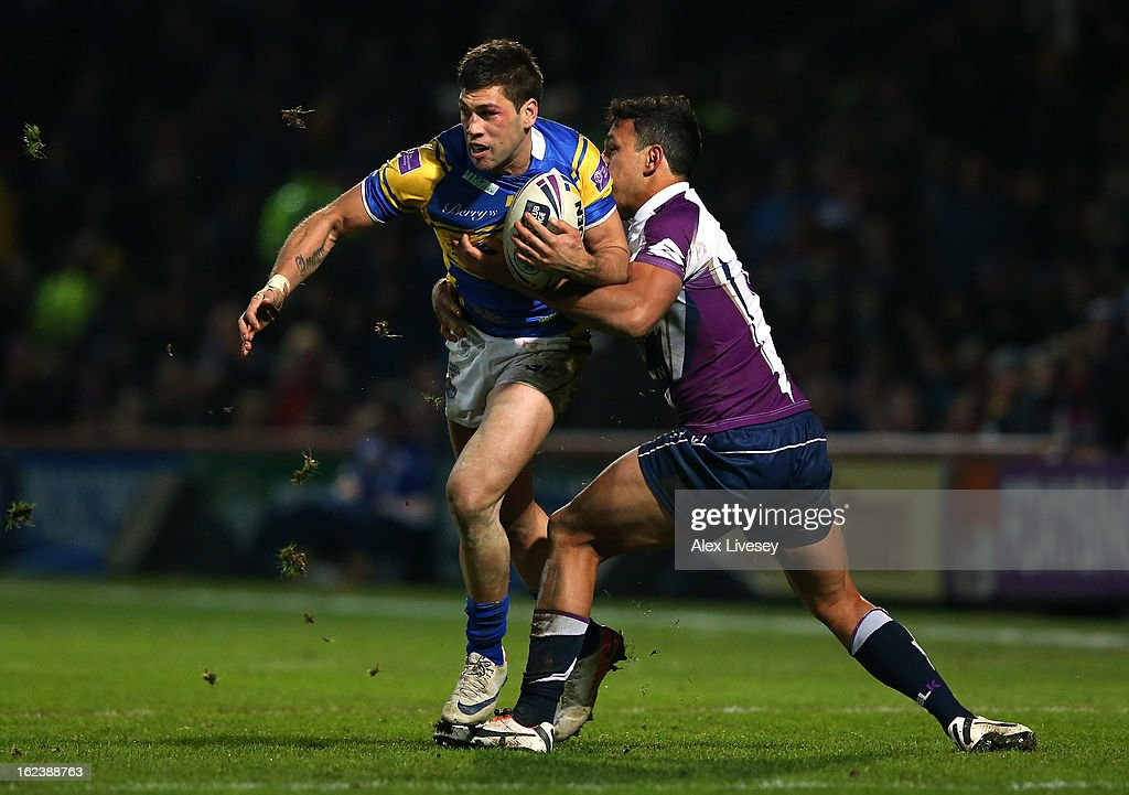 Joel Moon of Leeds Rhinos is tackled by <a gi-track='captionPersonalityLinkClicked' href=/galleries/search?phrase=Will+Chambers&family=editorial&specificpeople=4290838 ng-click='$event.stopPropagation()'>Will Chambers</a> of Melbourne Storm during the World Club Challenge match between Leeds Rhinos and Melbourne Storm at Headingley Carnegie Stadium on February 22, 2013 in Leeds, England.