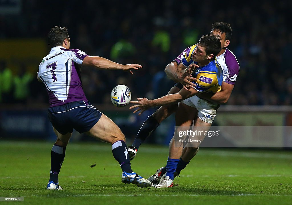 Joel Moon of Leeds Rhinos tries to pass the ball as he's tackled by <a gi-track='captionPersonalityLinkClicked' href=/galleries/search?phrase=Will+Chambers&family=editorial&specificpeople=4290838 ng-click='$event.stopPropagation()'>Will Chambers</a> of Melbourne Storm during the World Club Challenge match between Leeds Rhinos and Melbourne Storm at Headingley Carnegie Stadium on February 22, 2013 in Leeds, England.