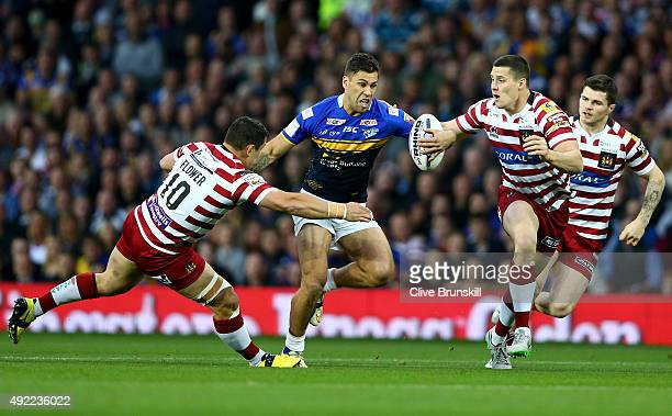 Joel Moon of the Leeds Rhinos is tackled by Ben Flower of the Wigan Warriors during the First Utility Super League Grand Final between Wigan Warriors...