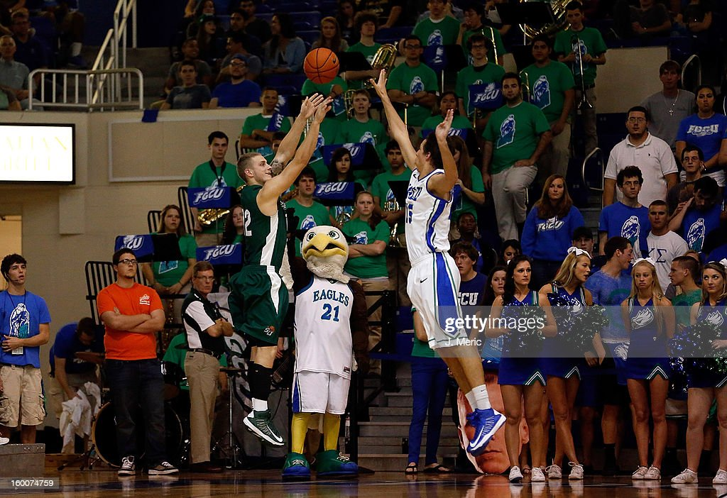 Joel Naburgs #12 of the Stetson Hatters shoots over Filip Cvjeticanin #15 of the Florida Gulf Coast University Eagles during the game at Alico Arena on January 25, 2013 in Ft. Myers, Florida.