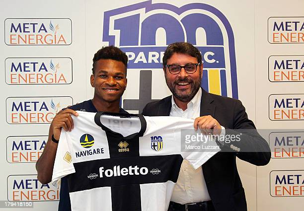 Joel Obi new signing of Parma FC poses with the club shirt and General Manager of Parma FC Pietro Leonardi during a press conference at the club's...