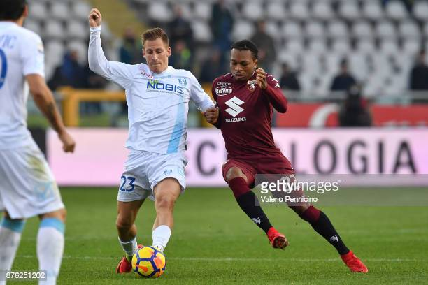 Joel Obi of Torino FC competes with Valter Birsa of AC Chievo Verona during the Serie A match between Torino FC and AC Chievo Verona at Stadio...
