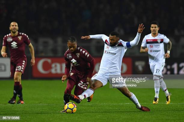 Joel Obi of Torino FC is tackled by Joao Pedro of Cagliari Calcio during the Serie A match between Torino FC and Cagliari Calcio at Stadio Olimpico...