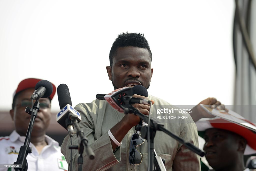 Joel Olatunde AGOI A picture taken on January 8, 2015 shows former Nigerian national football team's captain <a gi-track='captionPersonalityLinkClicked' href=/galleries/search?phrase=Joseph+Yobo&family=editorial&specificpeople=220395 ng-click='$event.stopPropagation()'>Joseph Yobo</a> speaking during a campaign rally for the re-election of Nigerian President Goodluck Jonathan in Lagos. Nigeria's politicians are turning to Nollywood film stars, popular musicians and former international footballers to win next month's election, in a campaign increasingly fought online. Africa's most populous country and biggest economy goes to the polls for presidential and parliamentary elections on March 28, with gubernatorial and state house assembly polls two weeks later.