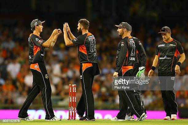 Joel Paris and Andrew Tye of the Scorchers celebrate the wicket of Ryan Carters of the Sixers during the Big Bash League match between Perth...