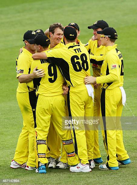 Joel Paris of the Warriors celebrates with team mates after taking the final wicket of Clive Rose of the Tigers during the Matador BBQs One Day Cup...
