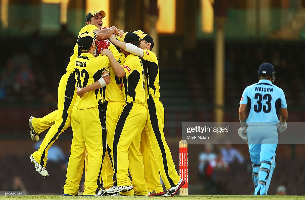 Joel Paris of the Warriors is congratulated after getting the wicket of <a gi-track='captionPersonalityLinkClicked' href=/galleries/search?phrase=Shane+Watson+-+Cricket+Player&family=editorial&specificpeople=171874 ng-click='$event.stopPropagation()'>Shane Watson</a> of the Blues during the Ryobi One Day Cup match between the New South Wales Blues and the Western Australia Warriors at Sydney Cricket Ground on January 30, 2013 in Sydney, Australia.