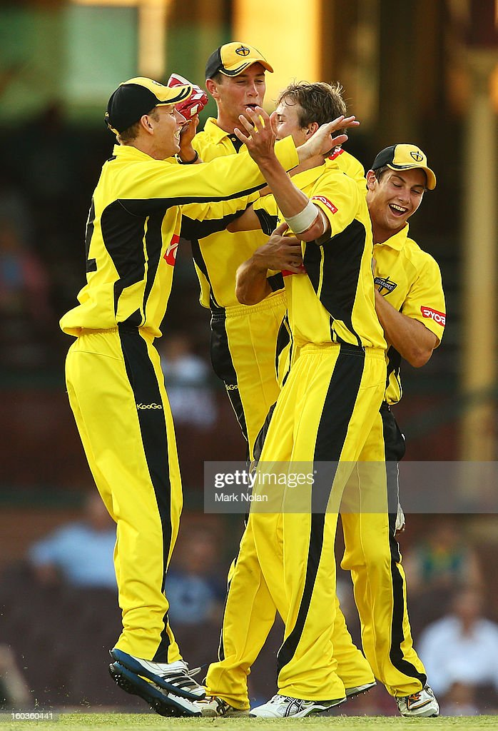 Joel Paris of the Warriors is congratulated after getting the wicket of Shane Watson of the Blues during the Ryobi One Day Cup match between the New South Wales Blues and the Western Australia Warriors at Sydney Cricket Ground on January 30, 2013 in Sydney, Australia.