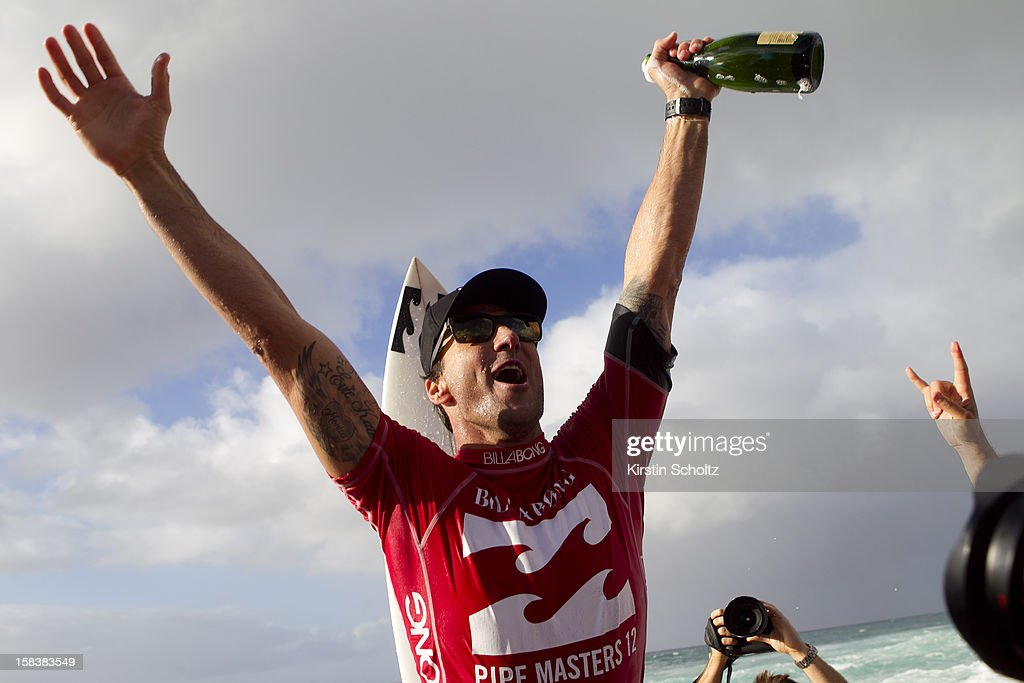 Joel Parkinson of Australia celebrates his first ASP World Title and Billabong Pipe Masters victory December 14, 2012 in North Shore, Hawaii.