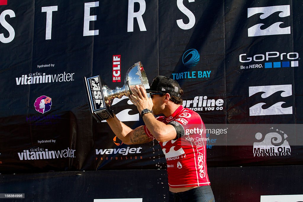 Joel Parkinson of Australia drinks from his his ASP World Champion trophy at the Billabong Pipe Masters in Memory of Andy Irons at Pipeline on December 14, 2012 in North Shore, United States.