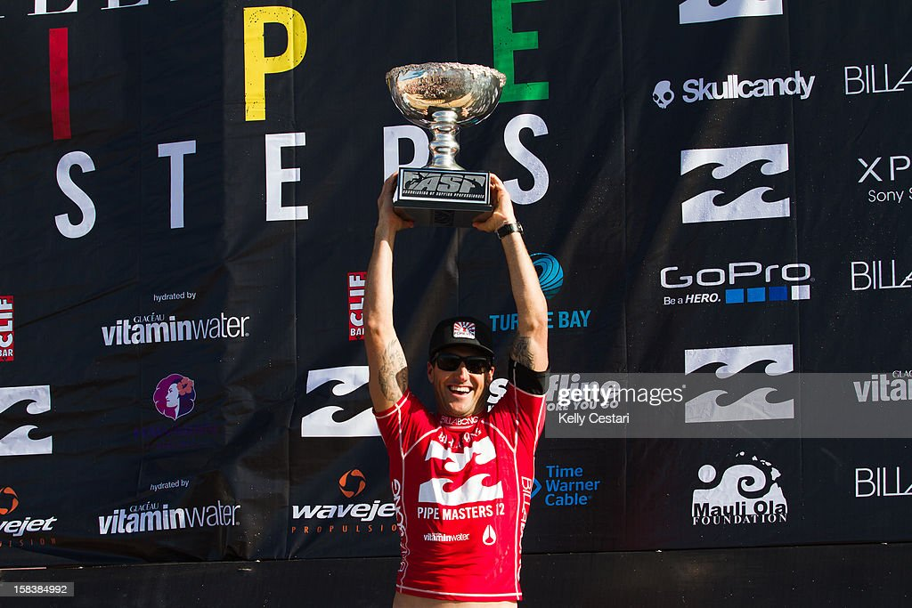 Joel Parkinson of Australia hoists his ASP World Champion trophy at the Billabong Pipe Masters in Memory of Andy Irons at Pipeline on December 14, 2012 in North Shore, United States.