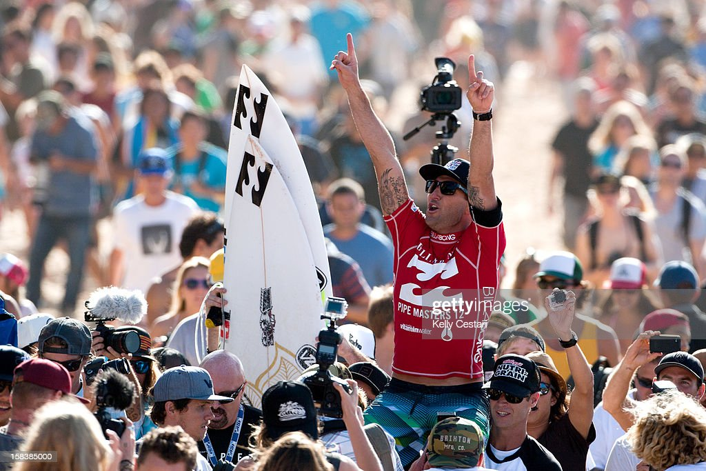 <a gi-track='captionPersonalityLinkClicked' href=/galleries/search?phrase=Joel+Parkinson&family=editorial&specificpeople=234875 ng-click='$event.stopPropagation()'>Joel Parkinson</a> of Australia is chaired up the beach to the prizegiving stage after winning the ASP World Title at the Billabong Pipe Masters in Memory of Andy Irons at Pipeline on December 14, 2012 in North Shore, United States.