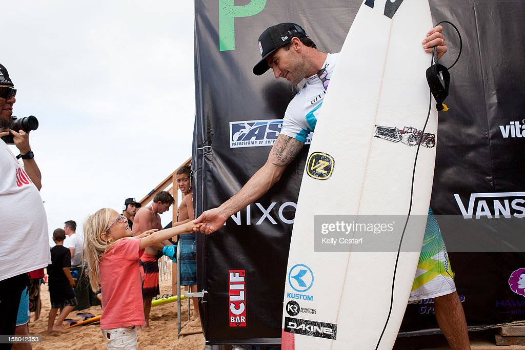 Joel Parkinson of Australia is congratulated by a young fan after winning his Billabong Pipe Masters Round 3 heat on December 9, 2012 in North Shore, Hawaii.